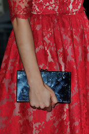 Michelle paired her lovely lace dress with a gorgeous box clutch.