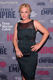 Patricia Arquette complemented her cocktail dress with a sparkly black tube clutch for a totally classy look during the 'Boardwalk Empire' season four premiere.