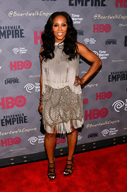 June Ambrose exuded a glam 1920s vibe in a fringed gray cocktail dress during the 'Boardwalk Empire' season four premiere.