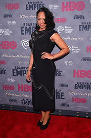 Margot Bingham chose a black cocktail dress with swirly safety pin embellishments for her red carpet look during the 'Boardwalk Empire' season four premiere.