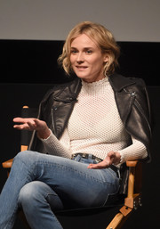 Diane Kruger topped off her look with a black leather moto jacket.