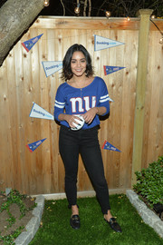 Vanessa Hudgens was casual and sporty in a NY Giants shirt at the Booking.com Football House gameday kickoff.