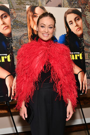 Olivia Wilde attended the New York screening of 'Booksmart' carrying a simple black satin clutch.