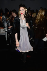 Kate Nash channeled old Hollywood with a purple bow dress and a black fur coat.