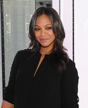 Zoe Saldana attended the BOSS fashion show wearing her hair down in feathery waves.