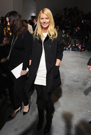 Gwyneth Paltrow layered a black coat over a white dress for a simple yet chic look during the Boss Women fashion show.
