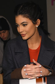 Kylie Jenner sported a white mani with blue accents at the Boss Fall 2016 show.