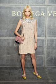 Soo Joo Park was hippie-chic in a fringed and beaded dress by Bottega Veneta during the brand's Fall 2018 show.