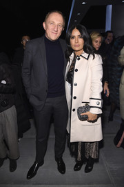 Salma Hayek went for edgy styling with a studded gunmetal clutch by Bottega Veneta.