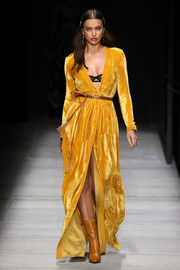 Irina Shayk brightened up the Bottega Veneta runway with this marigold velvet robe dress.