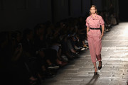 Gigi Hadid looked cool in a pink jumpsuit with scrunched-up sleeves while walking the Bottega Veneta fashion show.