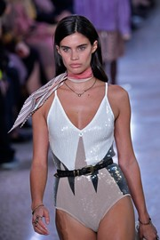 Sara Sampaio walked the Bottega Veneta show wearing a sequined bodysuit styled with a black leather belt.