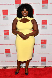 Danielle Brooks was modern and stylish in a curve-hugging yellow cutout dress at the Bottomless Closet spring luncheon.
