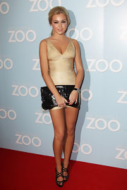 Chloe Cummings wore this shimmering gold bandage dress with black accessories to the 'We Bought a Zoo' screening.