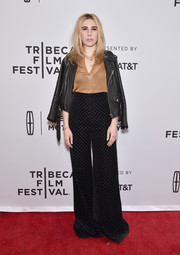 Zosia Mamet topped off her eye-catching ensemble with a black leather biker jacket.