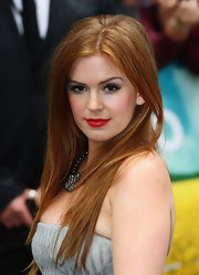 "The ""Wedding Crashers"" actress showed off her stunning red locks in a straight, center-parted style."