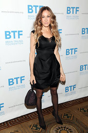 Sarah Jessica Parker added shine to her LBD with a glittery purple pochette.