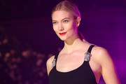 Karlie Kloss sported a simple center-parted ponytail while walking the Brandon Maxwell show.