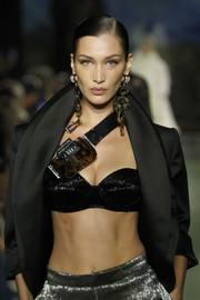 Bella Hadid flashed some skin in a shiny black bra while walking the Brandon Maxwell runway.