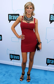 Alexis Bellino finished off her red carpet look with a sleek black leather clutch.