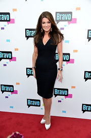 Lisa Vanderpump kept her red carpet look classic as ever with this V-neck little black dress.