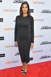 Padma Lakshmi donned a fitted black midi dress with a ruched midsection for the 'Top Chef' and 'Project Runway' Night of Food and Fashion event.