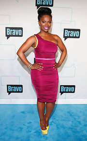 Kandi Burruss strode the blue carpet at Bravo Upfront 2012 wearing a complementary pair of pale yellow platform pumps.