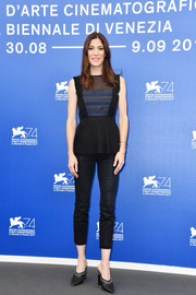 Jennifer Carpenter injected some edge with a pair of studded black mules.