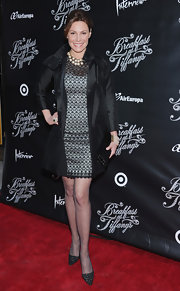 LuAnn de Lesseps paired her cocktail number with this black satin trench for a super-sophisticated red carpet look.