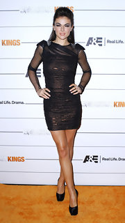 Serinda Swan paired her sultry black mesh dress with matching satin platform pumps.
