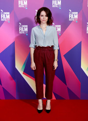 Claire Foy sealed off her simple ensemble with black Jimmy Choo pumps.