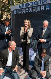 Bo Derek brightened up her black shirt and pants combo with a stylish taupe jacket.