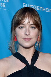 Dakota Johnson accessorized with a pair of red fringe earrings by Flaca Jewelry for a pop of color to her look while attending a UN event.