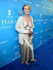 Sharon Stone dressed down her gown with a cream-colored shawl-collar cardigan.