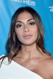 Nicole Scherzinger wore her hair loose with soft waves while attending a UN event.