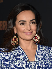 Ana De La Reguera attended the premiere of 'The Bridge' wearing gigantic gemstone chandelier earrings.