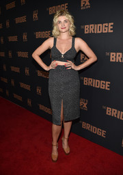 Megan Ferguson teamed her outfit with a pair of simple nude platform sandals.