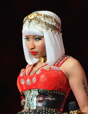 Nicki Minaj wore a gold head piece for her half time show performance.