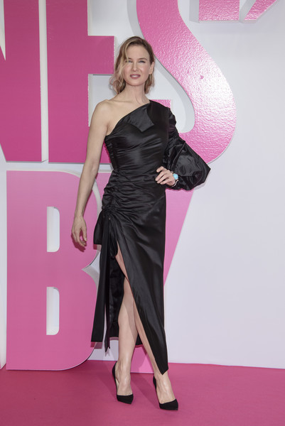 Renee Zellweger worked a ruched black one-shoulder dress by Monse, boasting a high side slit with bow detailing, at the Berlin premiere of 'Bridget Jones's Baby.'