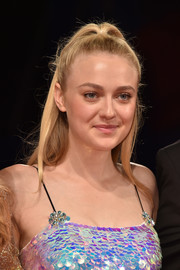 Dakota Fanning opted for a casual high ponytail when she attended the Venice Film Festival premiere of 'Brimstone.'