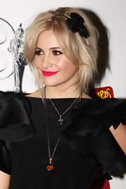 Pixie Lott gave her look an edgy appeal with a perfectly messy lose bun.