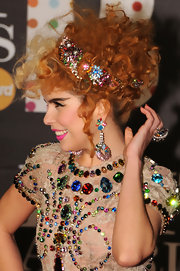 Paloma Faith is no stranger to outrageous 'dos like this undone curly updo with jeweled headband at the 2013 Brits.