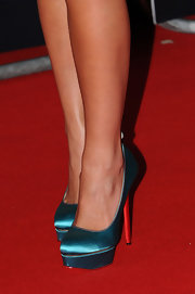 Katherine Jenkins' satin platform pumps had a red heel and trim that matched the red carpet at the 2013 Brits!