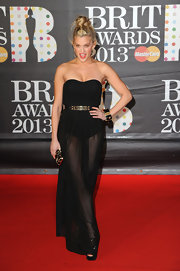 Ashley Roberts wasn't afraid to show some leg in this black strapless dress with a completely sheer skirt. An artful top knot gave this look even more edge.