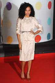 Corinne Bailey Rae took her love of fashion to the fete in this cool crinkled silk dress with an ultra-skinny belt. Her natural spiral curls were unbelievably perfect.