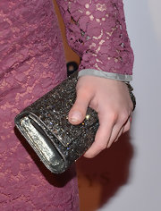Kelly Osbourne enhanced her lacy look by carrying this glittering silver clutch to the BritWeek event.