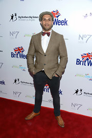 Stephen Uppal looked retro at the BritWeek Celebrates Downton Abbey event in a patterned tweed jacket and a matching ivy cap.