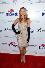 Ellen Hollman went for 1920s elegance with this embellished nude shift dress, complete with black full-sleeve gloves, at the BritWeek Celebrates Downton Abbey event.