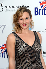 Sarah Farooqui looked very feminine at the BritWeek Celebrates Downton Abbey event with her side-swept curls.