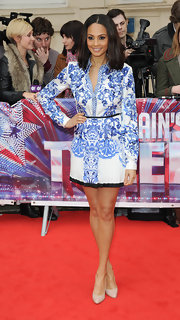 Alesha Dixon sported a blue-and-white floral button down and matching skirt for her chic and classy red carpet look.